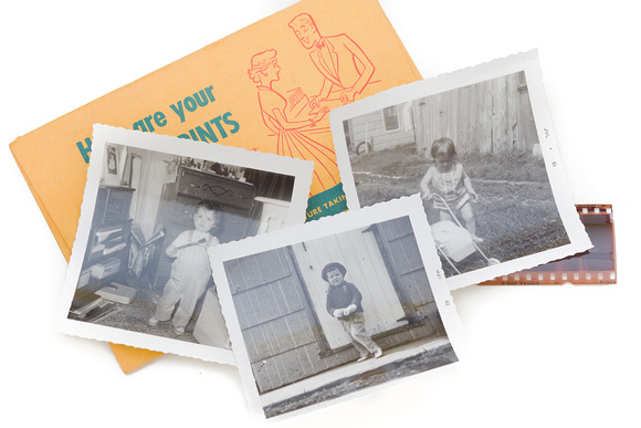 Three black and white snapshots with a photo envelope and piece